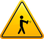 Man with a Disinfectant Spray Icon. This 100% royalty free vector illustration is featuring a yellow triangle button with rounded corners. The surface of the button is shiny and has a light effect on top. The main icon is depicted in black. There also a thin black outline around the edges of the triangle.