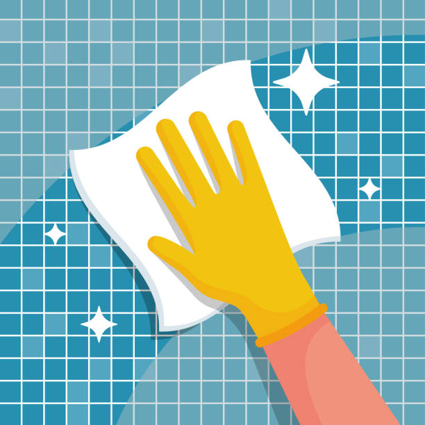 bezli bir adam banyodaki fayansları siler. temizlik konsepti. - cleaning stock illustrations