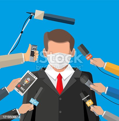 istock Man with face mask giving speech at conference 1219506614