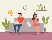 Man, woman and cat sitting on the sofa with notebook and smartphone. Vector flat illustration