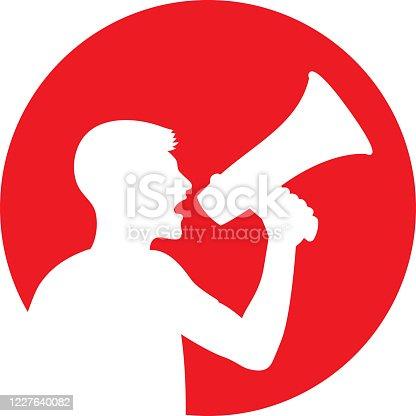 istock Man Yelling Through Megaphone Icon Silhouette 1227640082