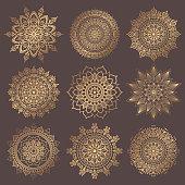 Mandala Vector Design Element. Golden round ornaments. Decorative flower pattern. Stylized floral chakra symbol for meditation yoga logo. Complex flourish weave medallion. Tattoo prints collection