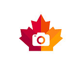 istock Maple Camera logo design. Canadian Photography logo. Red Maple leaf with Camera concept vector 1316306212