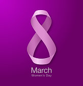 March 8 - Womens Day Paper Design of greeting card template. International Women's day Realistic symbol of pink ribbon on dark purple violet background. Vector illustration.