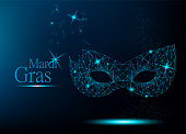 Mardi Gras blue polygonal carnival mask with lights for poster, greeting card, party invitation, banner or flyer on dark blue background. Vector Illustration.