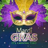 An invitation to the masquerade party for the Mardi Gras with feather carnival mask on the blue and purple colored background