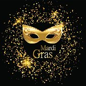 Mardi Gras golden carnival mask with ornaments for poster, greeting card, party invitation, banner or flyer on black background with golden sand. EPS10. Vector Illustration.