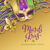 An invitation to the masquerade party for the Mardi Gras with jester mask, metallic fleur de lis and colorful beads on the gold colored background