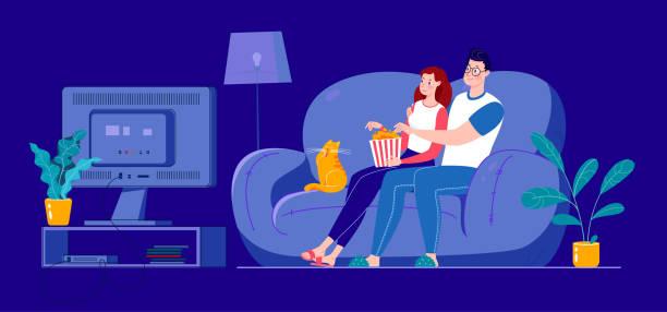 ilustrações de stock, clip art, desenhos animados e ícones de a married couple is watching a movie on a big screen, sitting on a sofa at home in a dark room. - tv e familia e ecrã