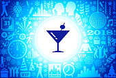 Martini Cocktail New Year Holiday Background Pattern. The main focus of this illustration is the icon which is placed in the center. It is dark blue in color and is inside a white glowing circle. The background is composed of the New Year holiday icons. The icons are blue in color and are placed against a slightly darker background. The icons include such New Year favorites as holiday party, New Year's clock, dancing, cityscape, fireworks and many more.