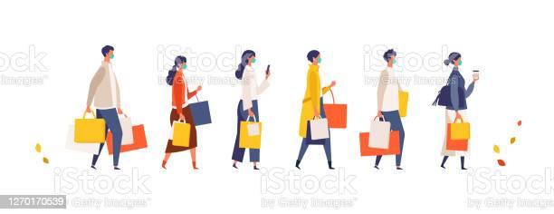秋に買い物袋を持っている仮面の人々新しい通常のライフスタイルに店舗ショップモールで季節の販売に参加する男女 - COVID-19のベクターアート素材や画像を多数ご用意