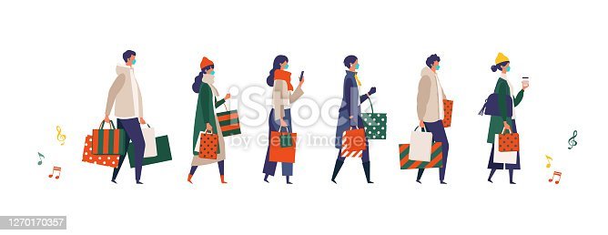 istock Masked people carrying shopping bags at Christmas. Man and woman taking part in seasonal sale at store, shop, mall on new normal lifestyle. 1270170357