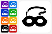 Masquerade Mask Icon Square Button Set. The icon is in black on a white square with rounded corners. The are eight alternative button options on the left in purple, blue, navy, green, orange, yellow, black and red colors. The icon is in white against these vibrant backgrounds. The illustration is flat and will work well both online and in print.