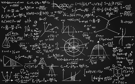 Math equations written on a blackboard - mathematics and science concepts