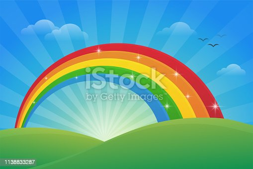 Meadow and the light of the sky in the morning with a beautiful rainbow.