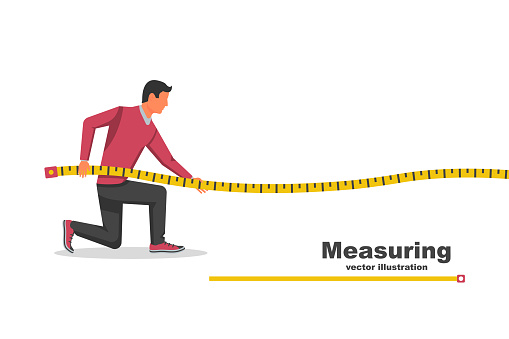 Measuring tape in the hands of the person making the measurements