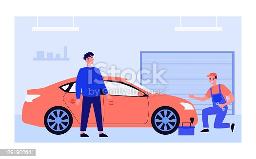 istock Mechanic examining and repairing red car 1291922541