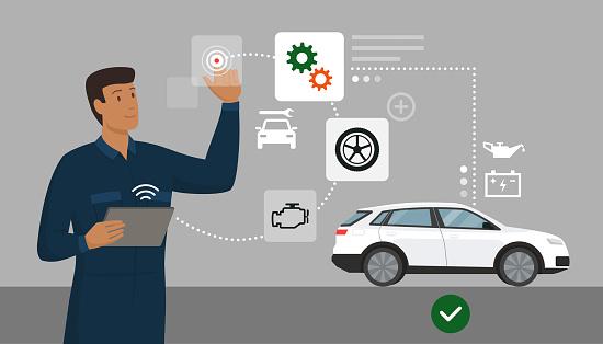 Mechanic performing a car inspection using a digital app