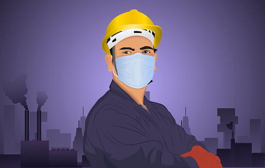 Mechanic wearing protective face mask looking at camera