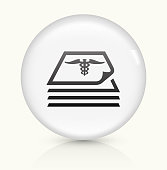 Medical Files Icon on simple white round button. This 100% royalty free vector button is circular in shape and the icon is the primary subject of the composition. There is a slight reflection visible at the bottom.