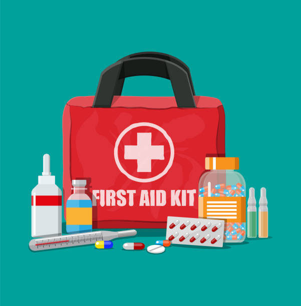 Medical first aid kit with pills and thermometer Medical first aid kit with different pills and thermometer. Healthcare, hospital and medical diagnostics. Urgency and emergency services. Vector illustration in flat style aspirin stock illustrations