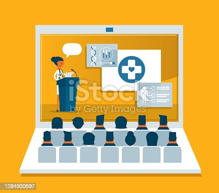 istock Medical Professional Giving Speech - Laptop 1284930597