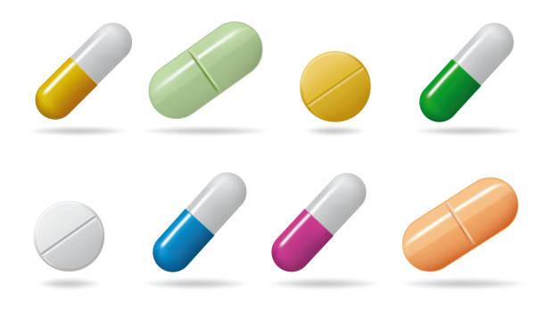 tabletki lecznicze. ustawianie tabletek w różnych kolorach. pojedyncze obiekty na białym tle - kapsułka stock illustrations