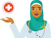 Friendly smiling arabian woman doctor in hijab and cross sign