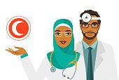 Practitioner young islam doctors man and woman standing together. Medical staff. Сrescent sign.
