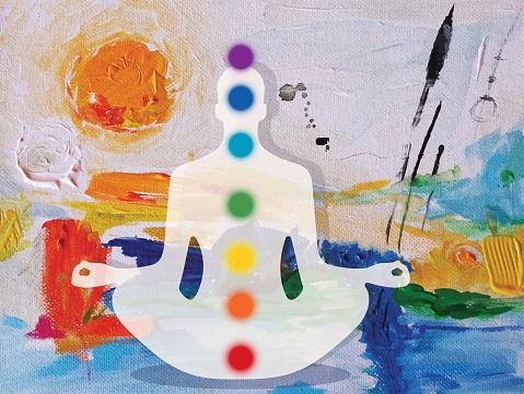 Meditating Human Lotus Pose And Chakras Placed On Abstract Acrylic Painting