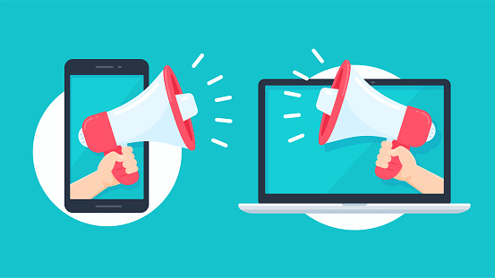 Megaphone reaching out from the smartphone and laptop screen to shout alerts for product promotions.
