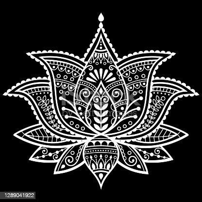 istock Mehndi henna tattoo lotus flower vector design, Indian ornamental pattern, Yoga or zen decoration, bohemian greeting card in white on black 1289041922