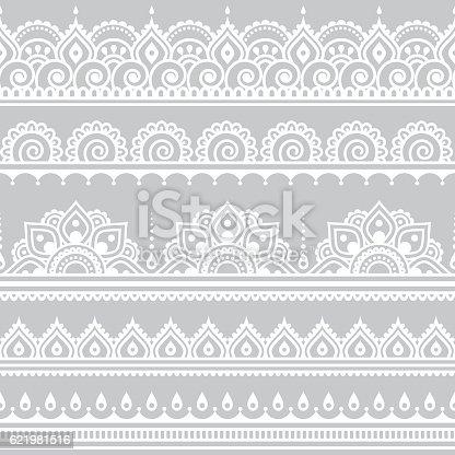 istock Mehndi, Indian Henna tattoo seamless white pattern on grey background 621981516