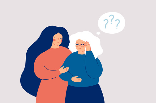 Memory loss concept. Senior woman has a mental disorder or amnesia. Nurse or social worker supports mature female with dementia.