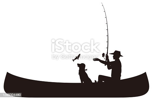 istock Men and dogs fishing in a canoe.silhouette 1285004480
