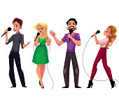 Men and women singing karaoke, holding microphones - competition, party, celebration