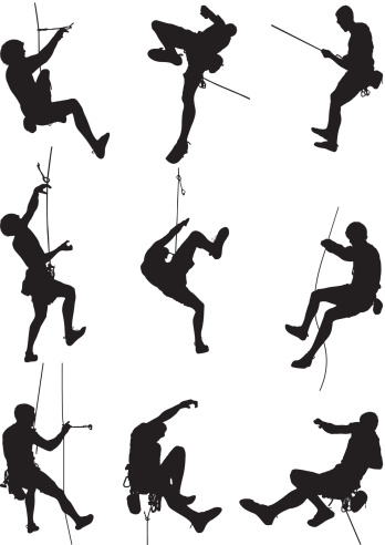 Men rappelling and rock climbing