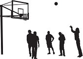 Men shooting hoops playing outdoor basketball