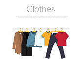 istock Men's and woman's clothes on hangers, vector illustration 1254330091