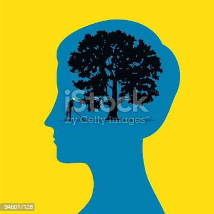 A gardener looks after a tree inside the silhouette of a woman head
