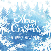 """Greeting card winter motif as watercolor painting with hand drawn branches and fir trees in the background. Lettering """"Merry Christmas & a happy new year"""" in the middle. Blue watercolor background can be used separatly."""