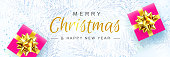 istock Merry Christmas and Happy New Year. Christmas background with white Pine Branches, Red Gift boxes with a Gold Bow. Creative design for Greeting Cards, banners, posters. Top view 1288838176