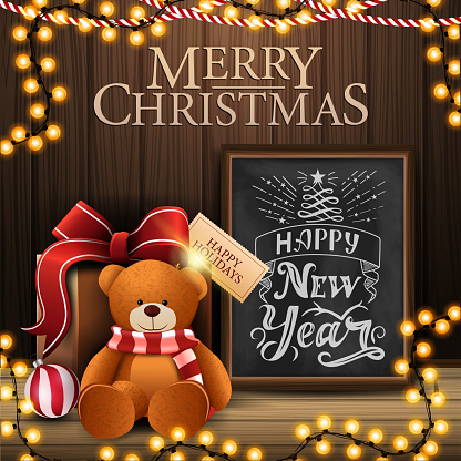 Merry Christmas and happy New Year, postcard with cozy interior with wooden wall, garland, chalk board with beautiful greeting lettering and present with Teddy bear