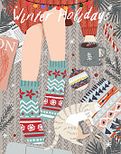 istock Merry Christmas and Happy New Year! Vector illustration of a cozy winter still life with a top view: a girl with a cup of coffee in socks, a pet cat, Christmas tree branches, Christmas balls. 1279817558