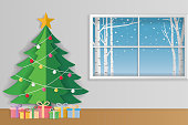 Merry Christmas and winter season greeting card. Christmas tree and gift boxes with winter background outside of window. Paper art style. Vector illustration.