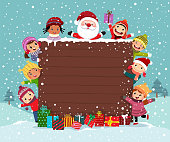 Merry Christmas Backgroud wooden board with group of kids and Santa Claus in snow day.