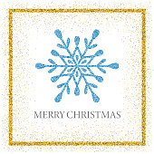 "Christmas greeting card with a glitter snowflake and the words ""Merry Christmas"""