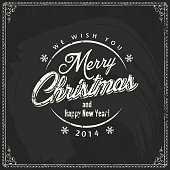 Merry Christmas card on a chalkboard with calligraphic and typographic elements.