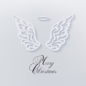 White beautiful angels ornamental wings and halo on a light background. Outline décor with shadow. Greeting card in paper cut style, advertising, discount, poster for holidays, carving.