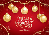 Merry Christmas and Happy New Year greeting card or banner template with realistic golden Christmas balls, stars and sequins. Handwritten elegant lettering on a red background. Vector illustration